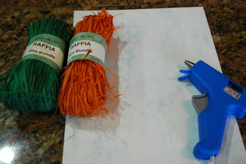 Supplies to make raffia carrots for Easter.